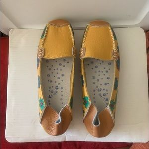 Women's size 10 yellow shoes with blue flowers!